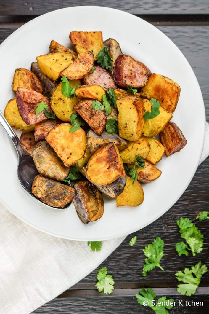 Easy Roasted Potatoes on a serving dish with fresh parsley.