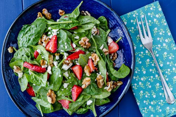 Spinach Strawberry Salad with walnuts and feta cheese and a homemade poppy seed dressing.