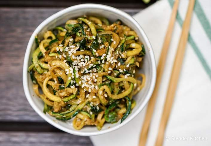 Asian Zucchini Noodles in a bowl with sesame seeds.